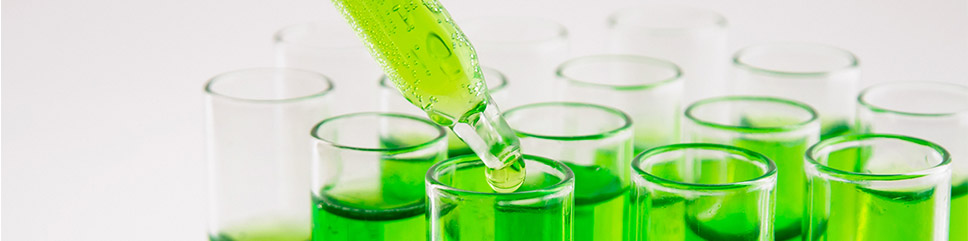 Test tubes containing a green chemical.